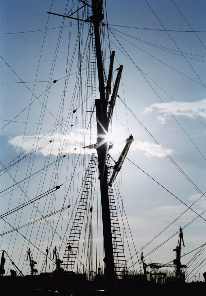 Stock Photo: 1570R-116628 Ship's mast and rigging in silhouette