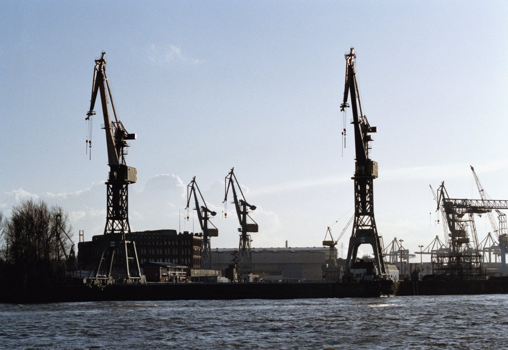Cranes on a commercial dock : Stock Photo
