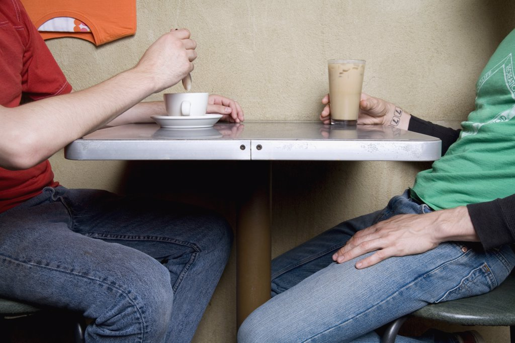 Stock Photo: 1570R-117028 Two people sitting in a cafe