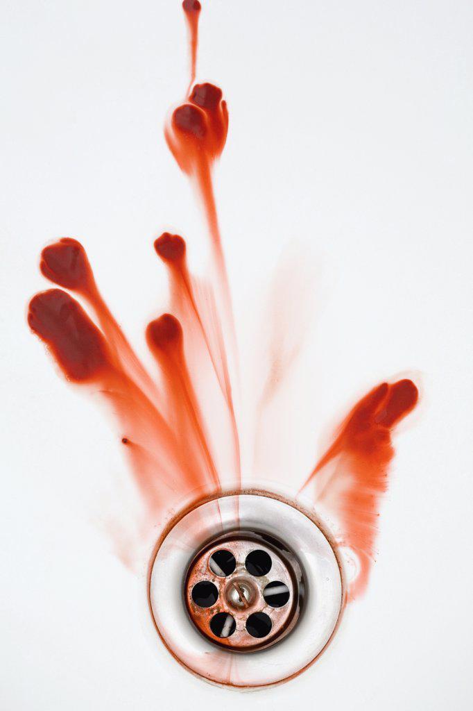 Stock Photo: 1570R-118410 Blood washing down a plughole