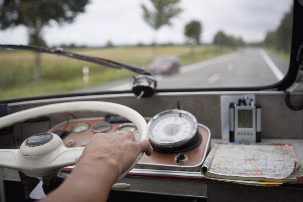 Close up of hand on steering wheel : Stock Photo