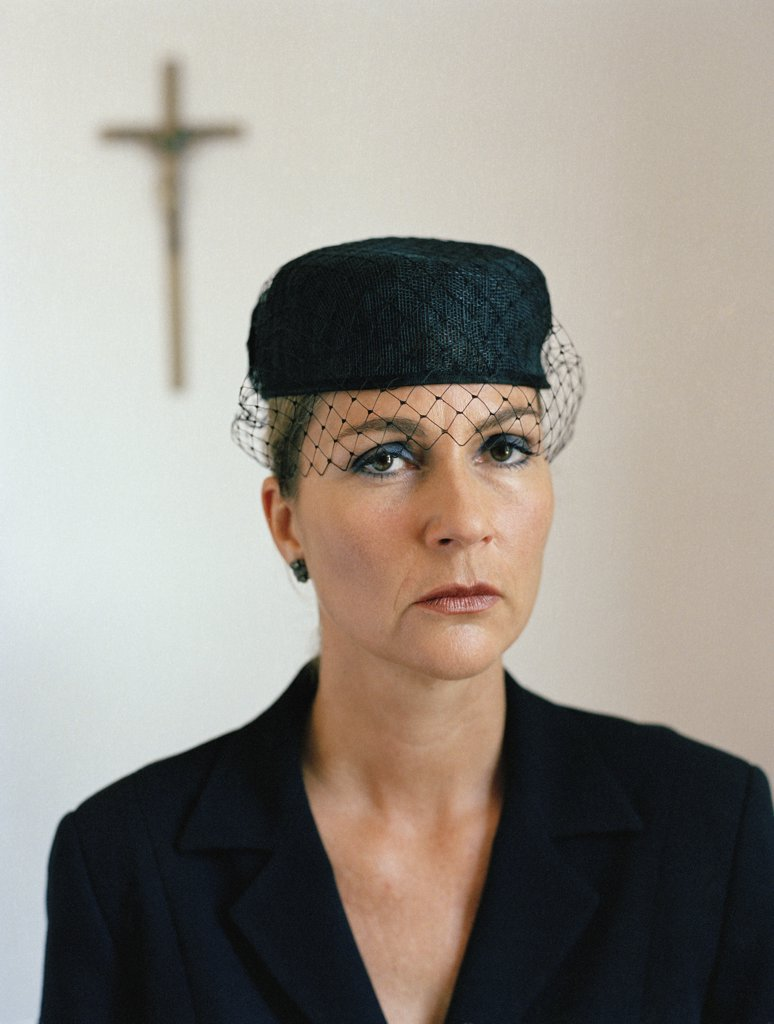 Stock Photo: 1570R-118694 Portrait of a woman dressed in black at a church