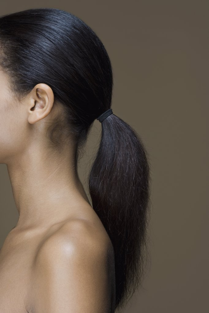 Side view of a woman with long black hair : Stock Photo
