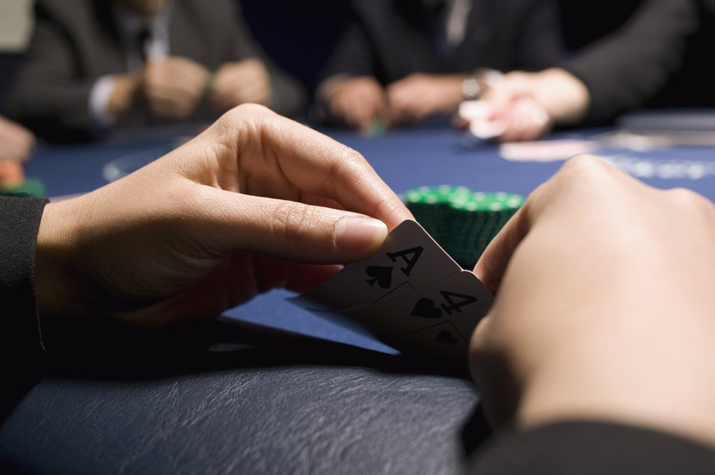 Hand holding playing cards : Stock Photo