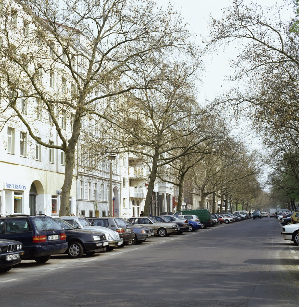 Cars parked in a row in front of residential buildings, Berlin, Germany : Stock Photo