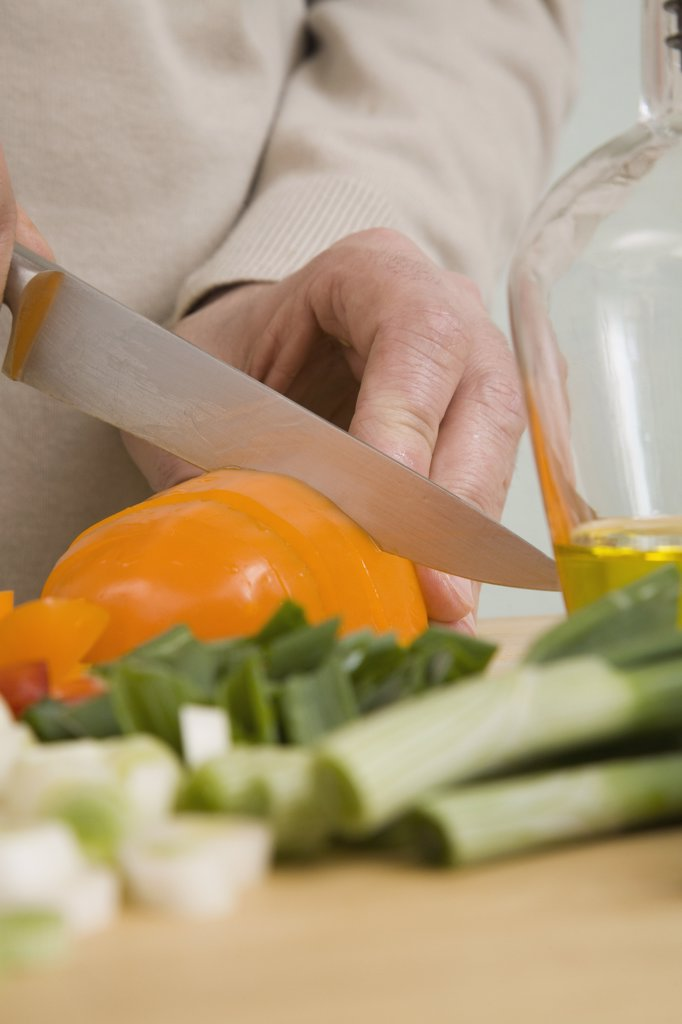 A man chopping vegetables : Stock Photo