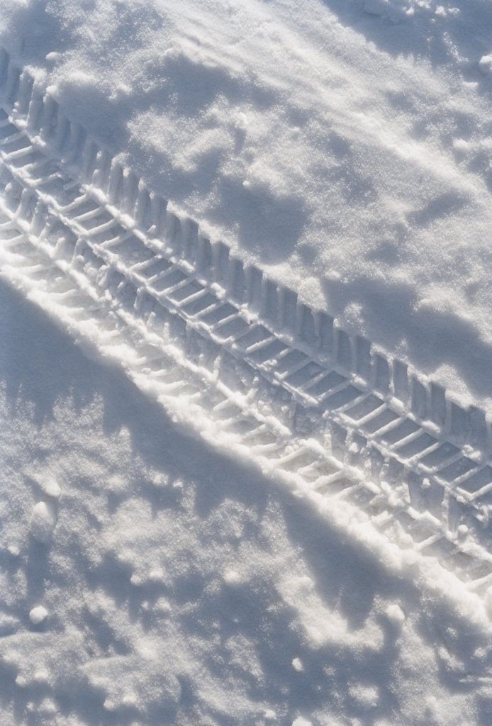 Stock Photo: 1570R-120711 Tire track in the snow