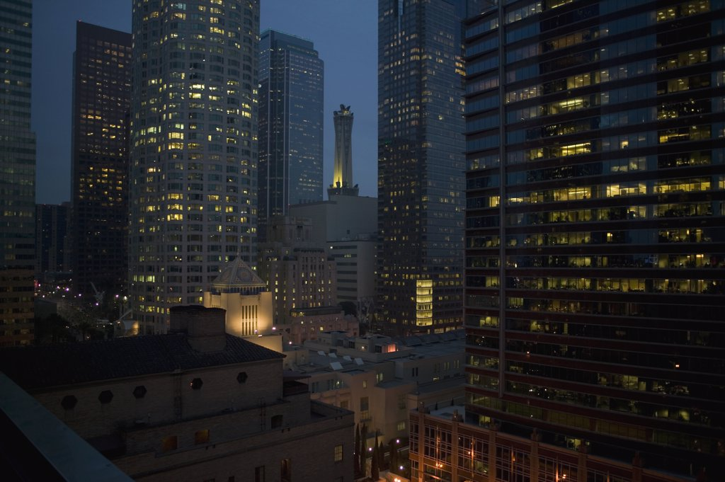 Illuminated skyscrapers in the downtown district at night, Los Angeles, California : Stock Photo