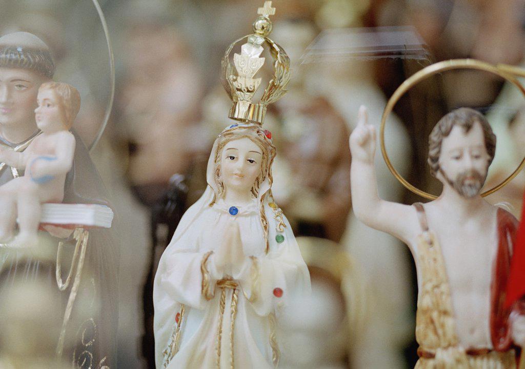 Christian statuettes : Stock Photo