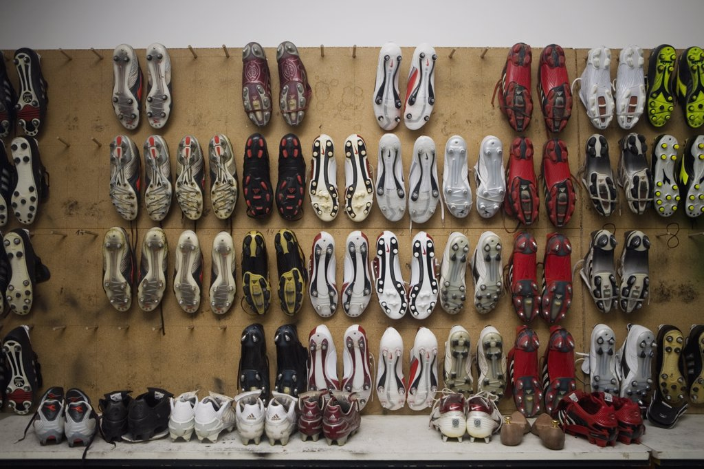 Stock Photo: 1570R-121917 Football boots hanging on a wall