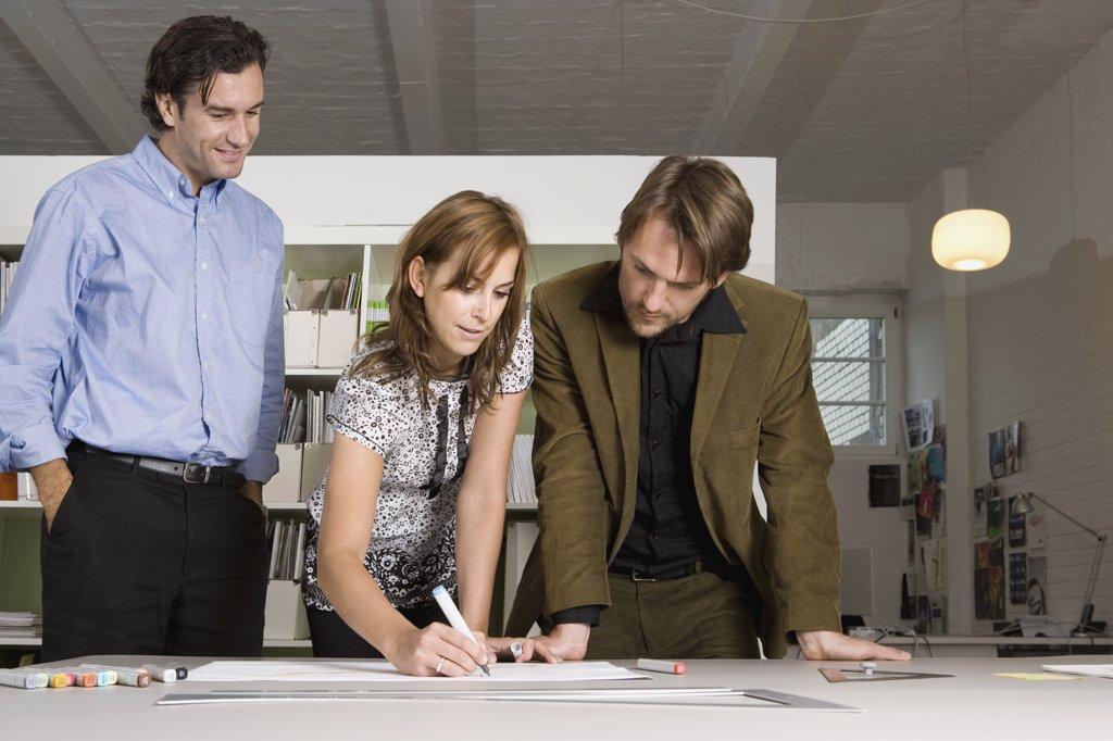 Stock Photo: 1570R-122181 Three people brainstorming in an office
