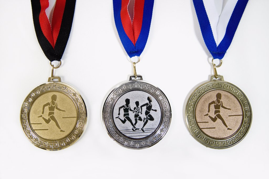 Stock Photo: 1570R-122447 Studio shot of a gold medal, silver medal and a bronze medal