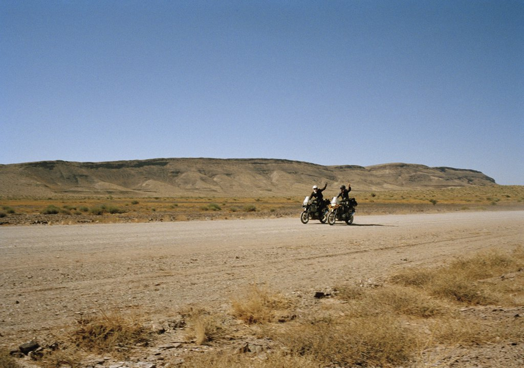 Stock Photo: 1570R-122603 Two motorcyclists waving