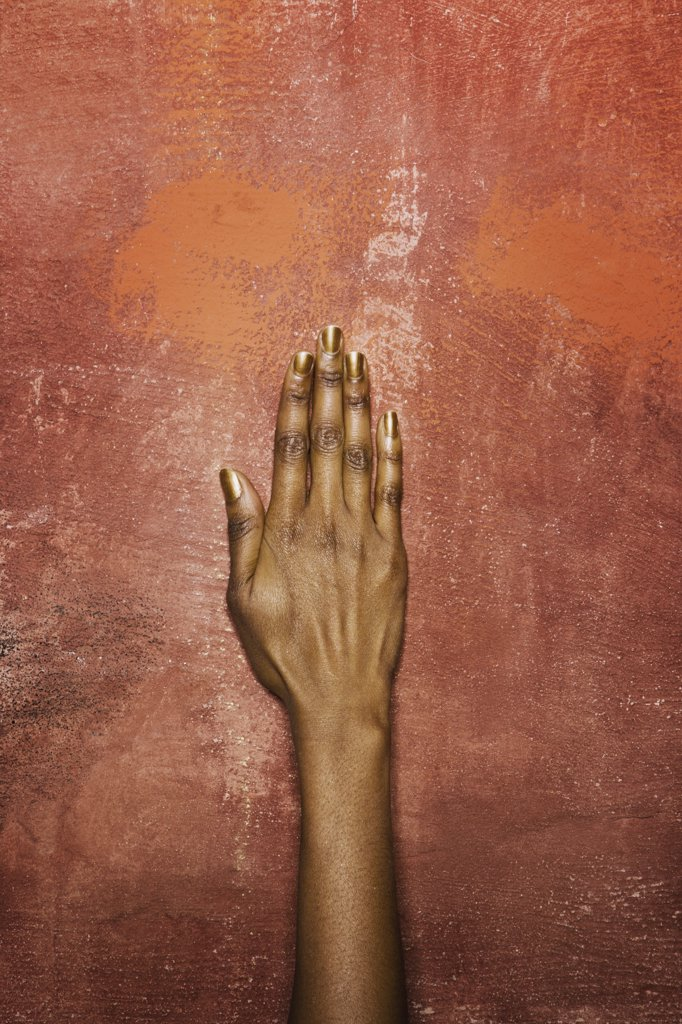 Stock Photo: 1570R-123221 A woman's hand in front of a wall