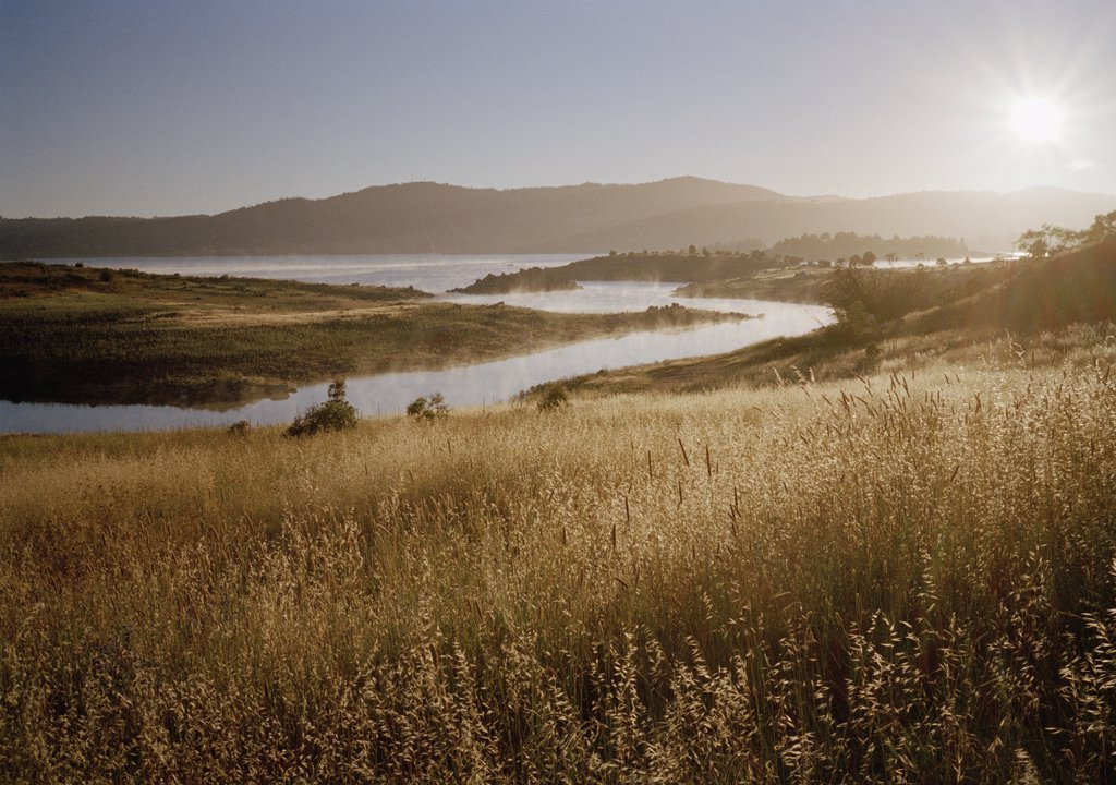 Stock Photo: 1570R-123403 Scenic shot of fields, river and a mountain