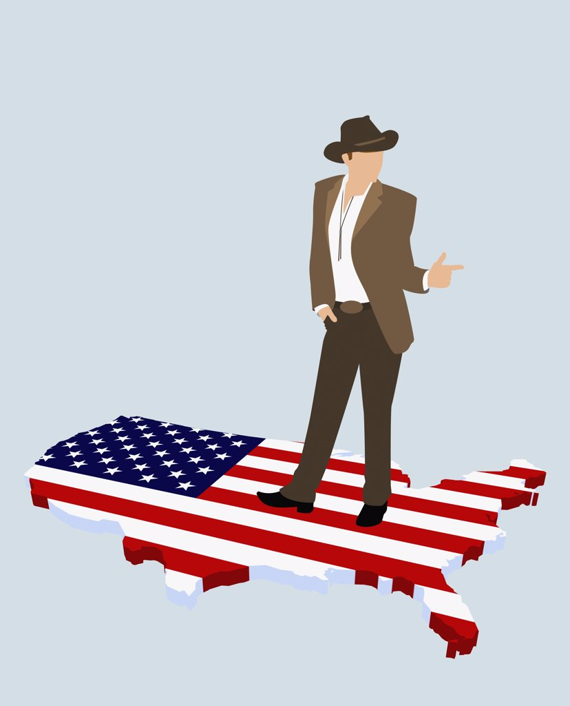 A stereotypical American cowboy standing on the American flag in the shape of America : Stock Photo