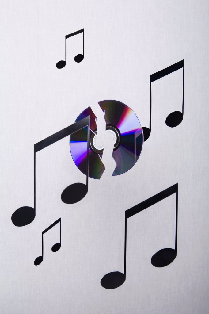 Stock Photo: 1570R-123820 Musical notes and a CD suspended in mid-air