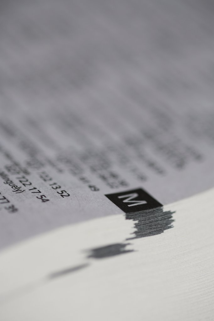 Extreme close-up of 'm' in a phonebook : Stock Photo