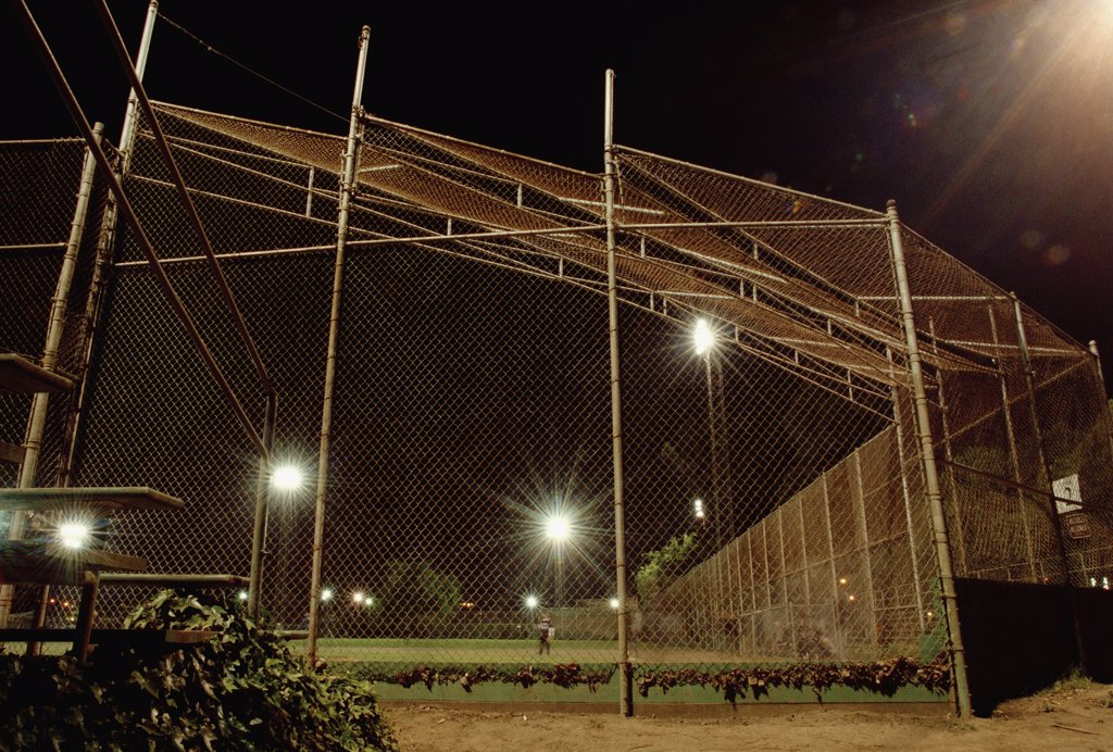 A sports field illuminated at night : Stock Photo