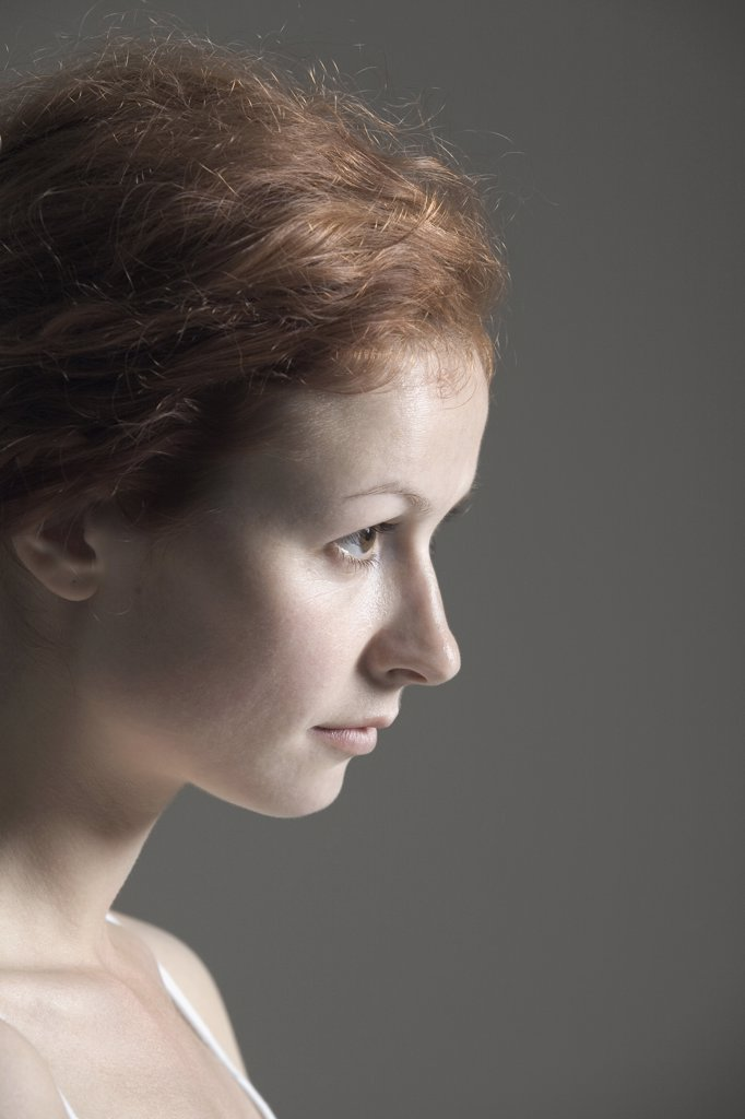 Portrait of a young woman with red hair : Stock Photo