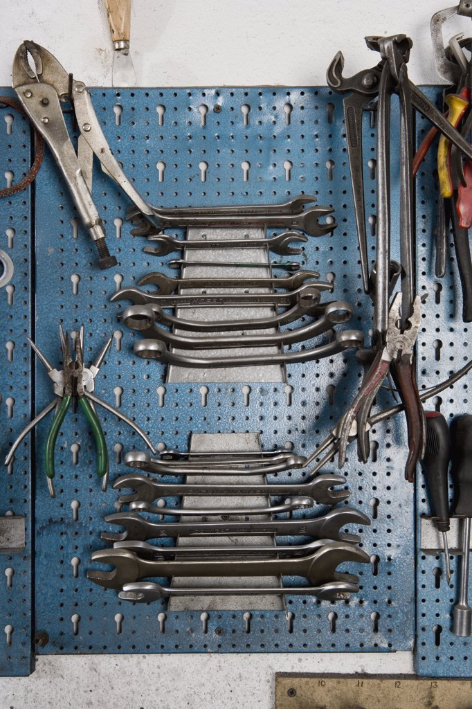 Tools hanging on a workshop wall : Stock Photo