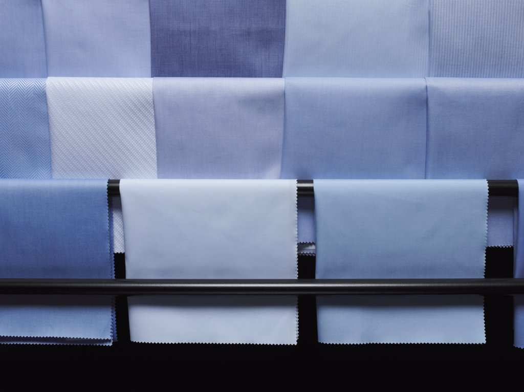 Blue fabric swatches on a rack : Stock Photo
