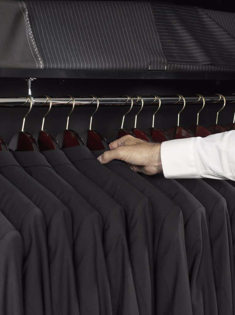 Stock Photo: 1570R-124804 A man selecting a jacket from a clothing rail