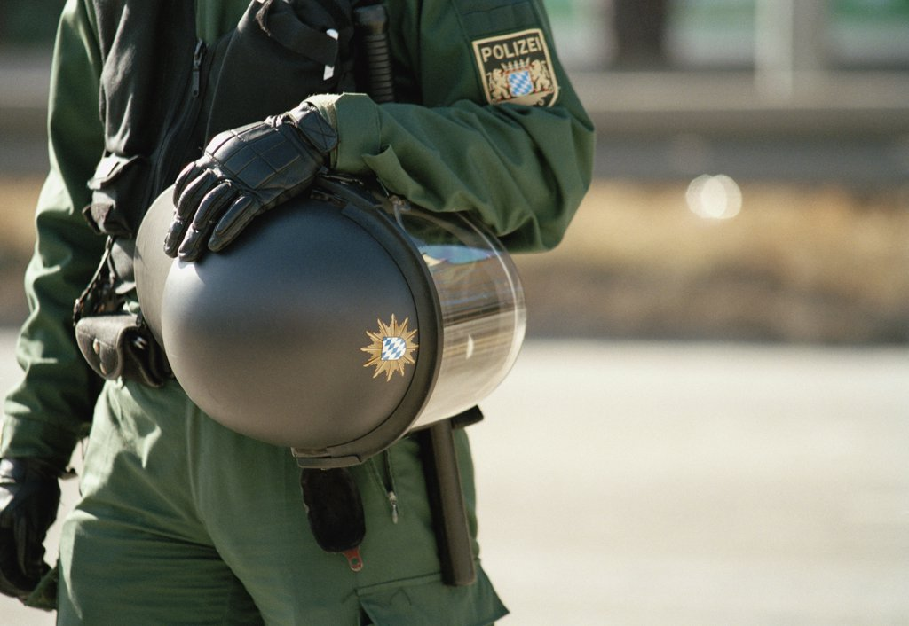 A German police officer wearing protective clothing : Stock Photo