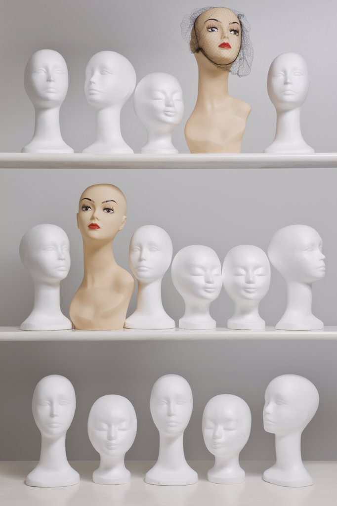 Mannequin busts on shelves : Stock Photo