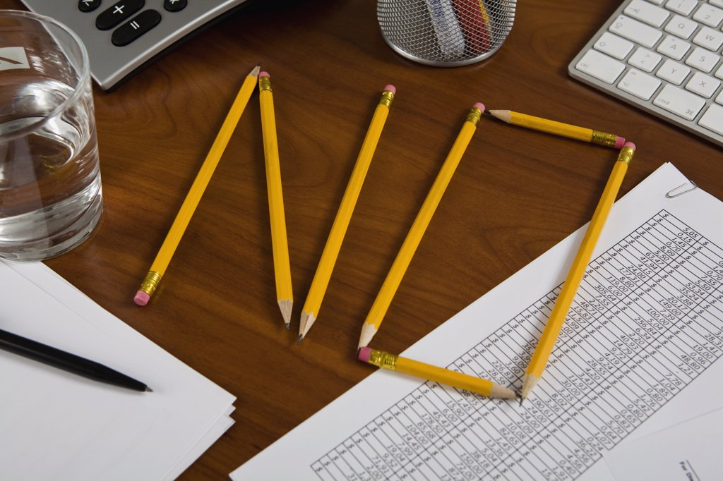 Stock Photo: 1570R-125662 Pencils on a desk arranged to spell No