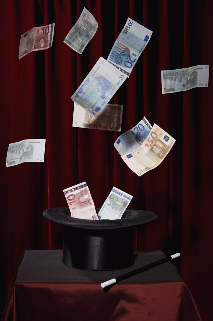 European Union currency bills coming out of a top hat at a magic show : Stock Photo