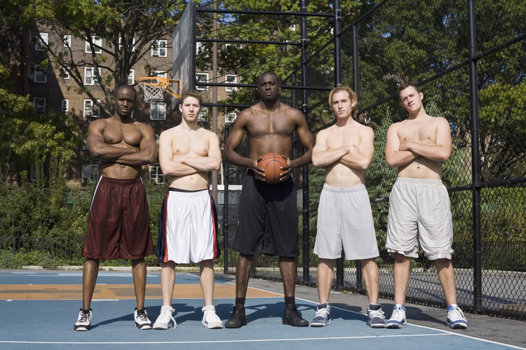 Five basketball players, in a row : Stock Photo