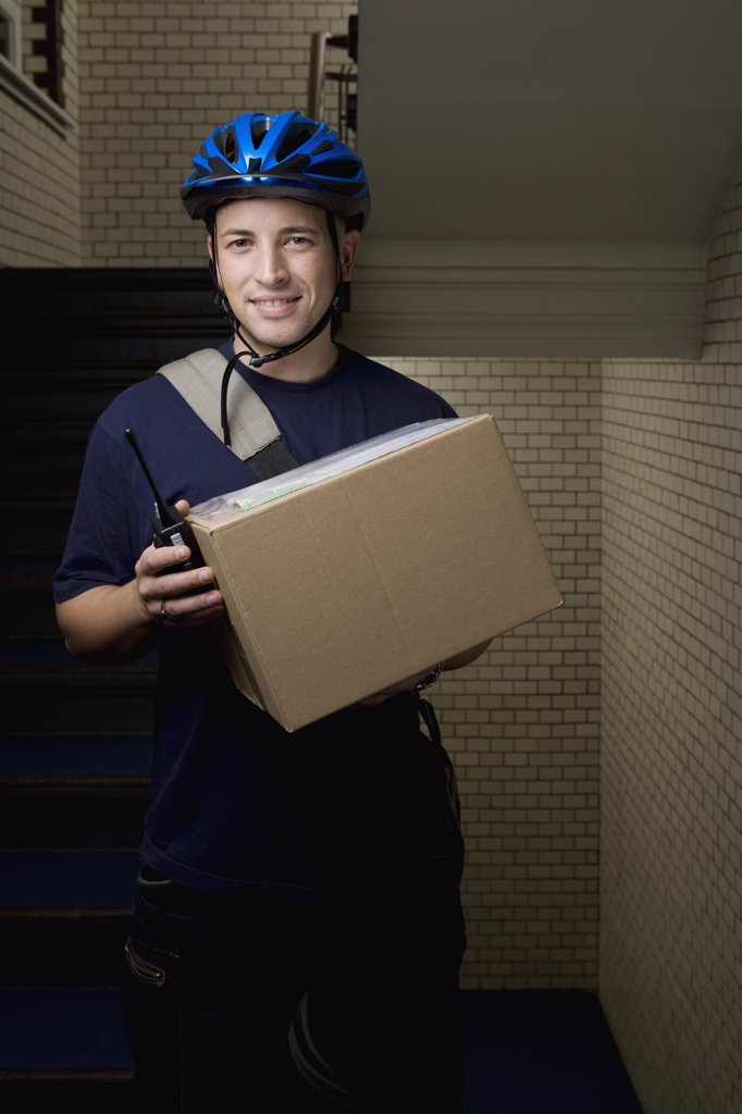 A bicycle messenger delivering a package : Stock Photo