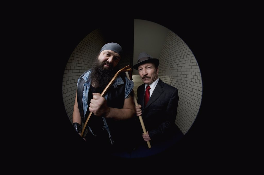 Stock Photo: 1570R-126351 An organized crime boss with his bodyguard, viewed through a peephole