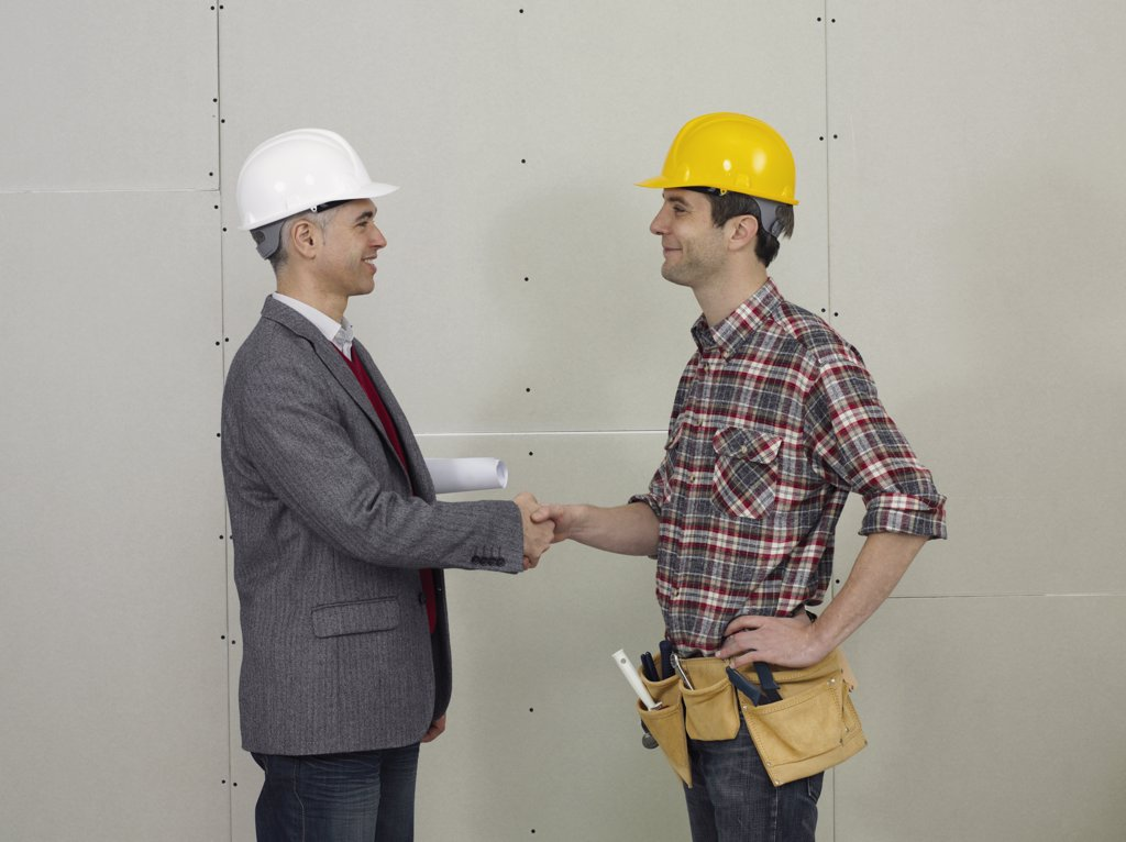 Stock Photo: 1570R-126675 An architect shaking hands with a construction worker