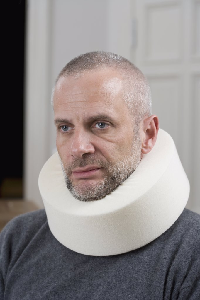 A man wearing a neck brace : Stock Photo