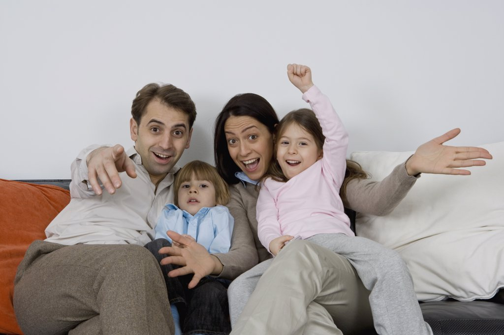Stock Photo: 1570R-127034 A family of four with excited expressions