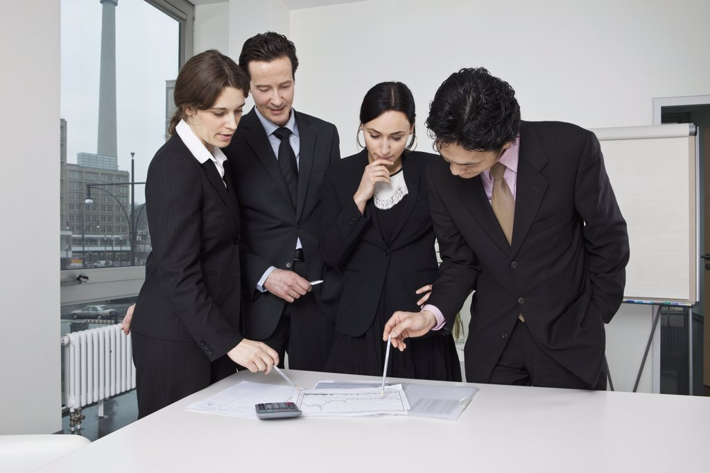 Four business people in a business meeting : Stock Photo