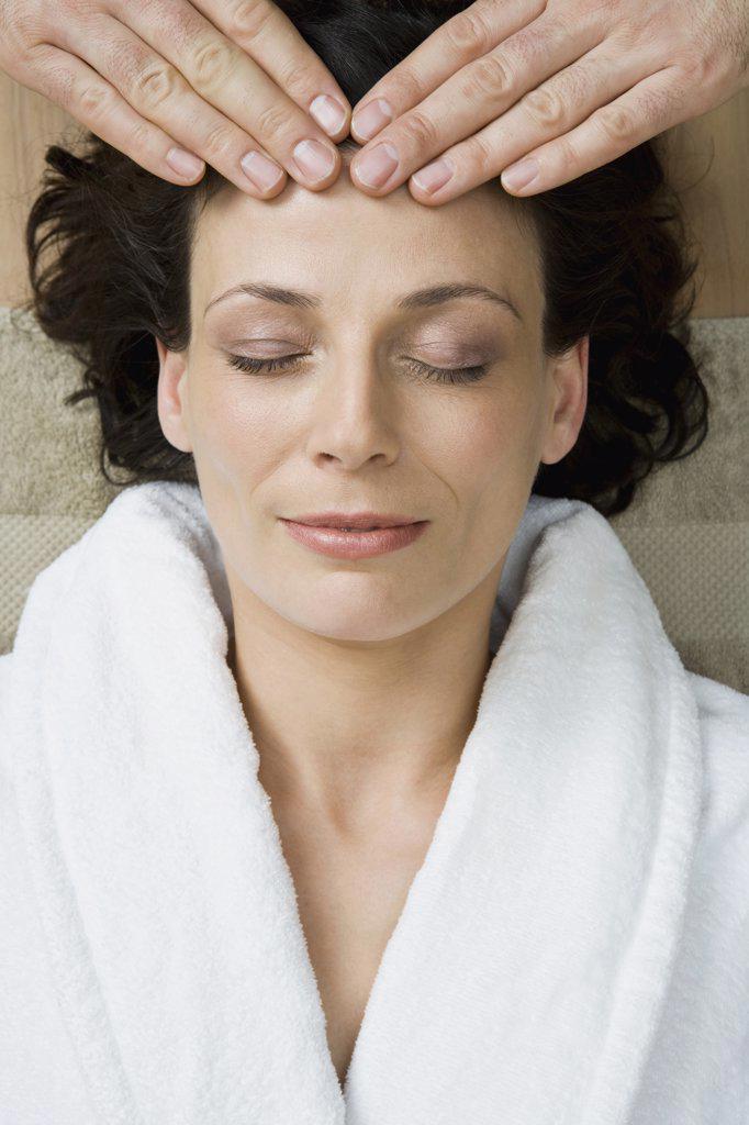 Stock Photo: 1570R-127616 A woman having a head massage