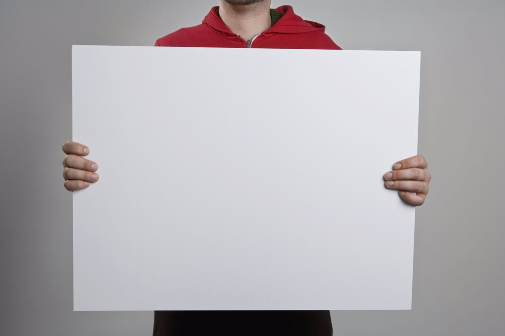 A man holding a blank sign : Stock Photo