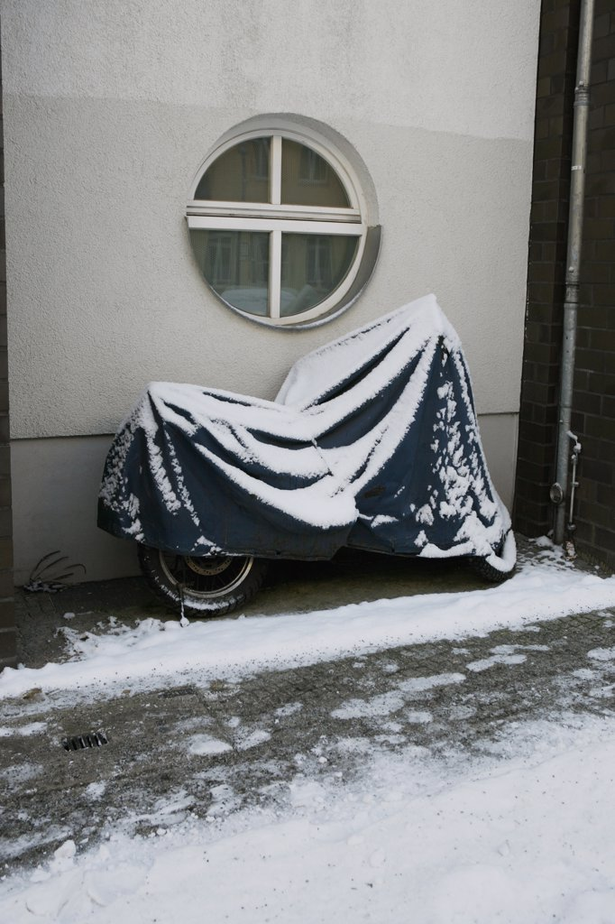 A motorcycle covered in snow : Stock Photo