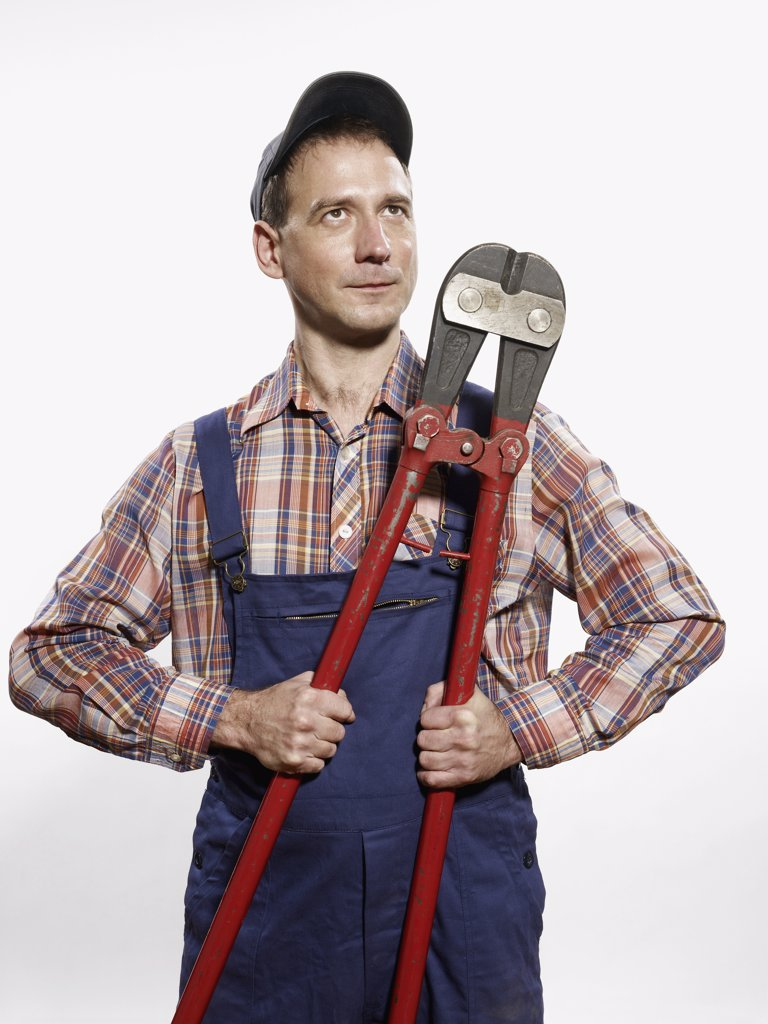 A man holding bolt cutters : Stock Photo