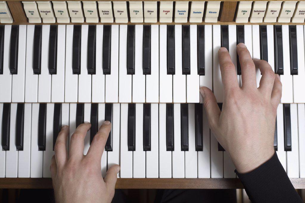 Stock Photo: 1570R-128301 Human hands playing a organ