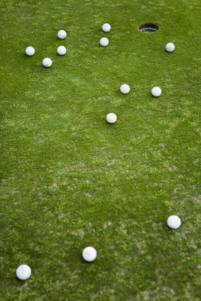 Stock Photo: 1570R-128537 Golf balls on a putting green