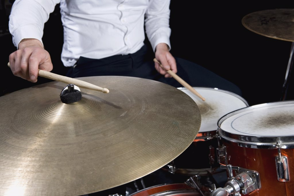 Detail of a man playing drums : Stock Photo
