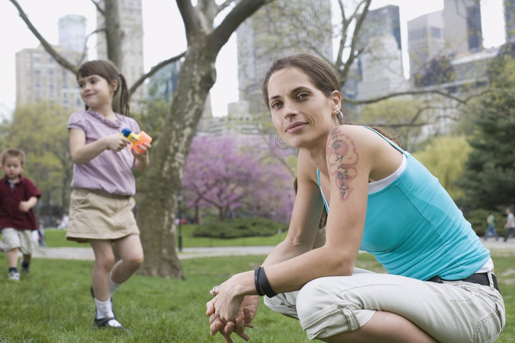 A woman and her children in Central Park, New York City : Stock Photo