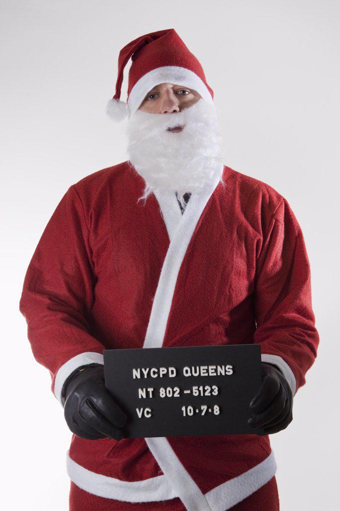 Stock Photo: 1570R-128995 Santa Claus posing for a mug shot