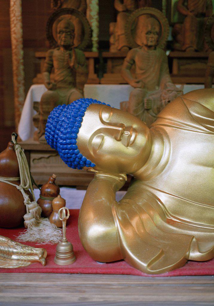 Detail of a gold reclining Buddha statue, Miyajima, Japan : Stock Photo