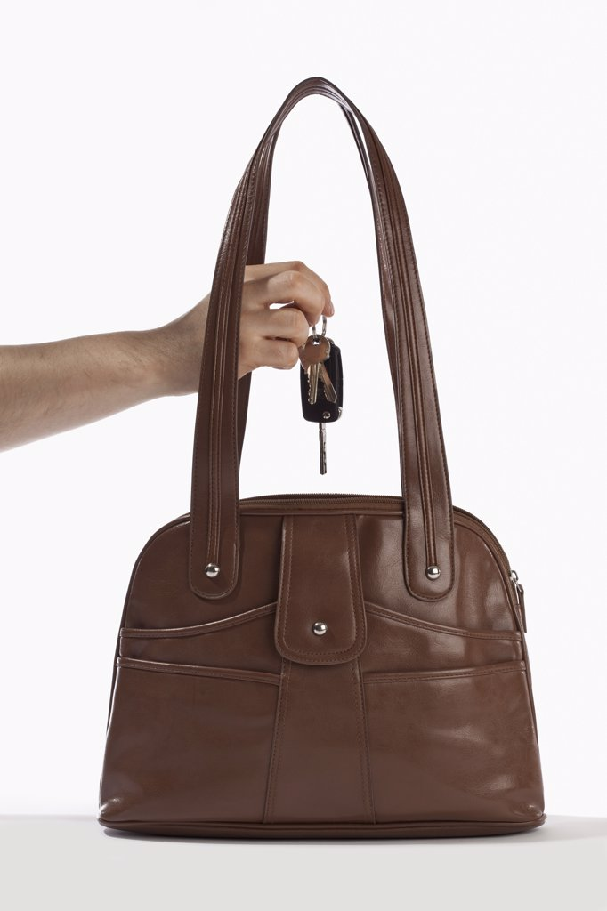 Stock Photo: 1570R-131852 Detail of a man taking keys out of a handbag