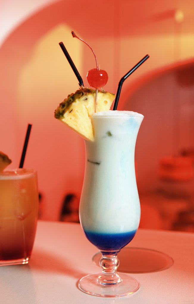 Stock Photo: 1570R-132228 Two cocktails on a bar counter